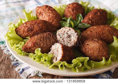 Tasty Food Kibbeh With Bulgur, Onion And Pine Nuts Macro. Horizontal