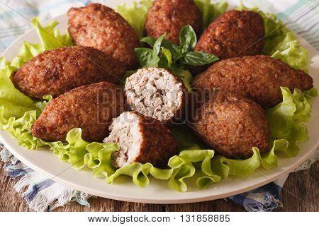 Arabic Cuisine: Meat Appetizer Kibbeh Close-up. Horizontal
