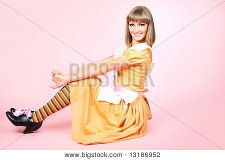 Portrait of a beautiful housewife. Studio shot.