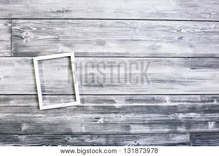 Small see-through frame on antique wooden wall. Mock up