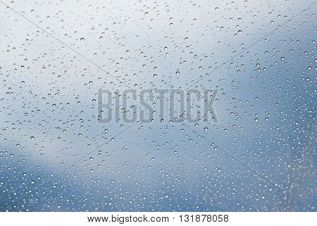 drops on the skylight on a sky background