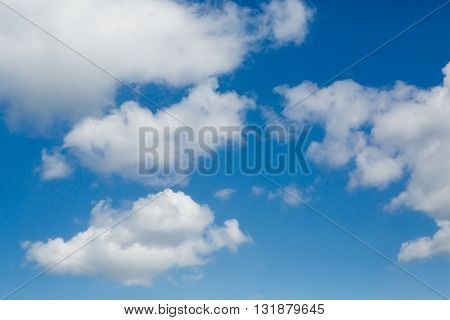 Big clouds in the blue sky. Good cloudy weather. The sky above us. Background and texture of the cloudy sky.
