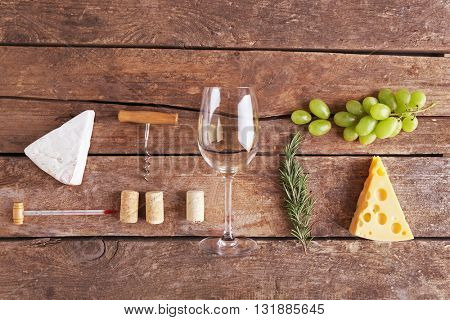 Wine, snacks and different various of cheese, flat lay