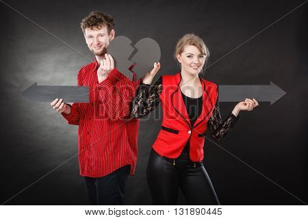Young Pair Showing Heartbreak Symbols.