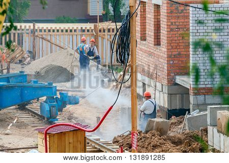 Molodechno. Belarus - May 29, 2016: Construction of a multi-storey brick house in the city center.