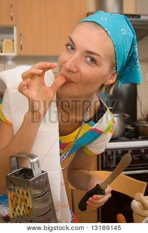 Girl is cooking in the kitchen