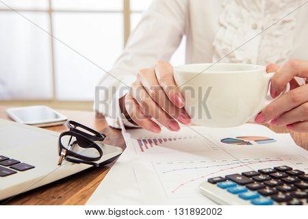 Businesswoman Savoring Her Morning Coffee