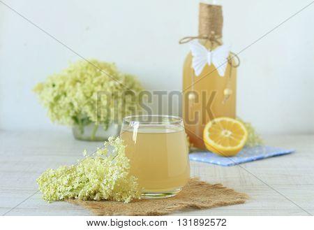 Elderberry flower drink with sliced lemon on a table