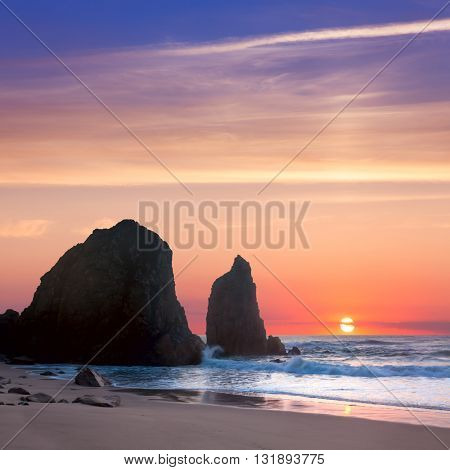 Sea Landscape at Sundown romantic time,  big rocks and stones beach. Portugal, Europe