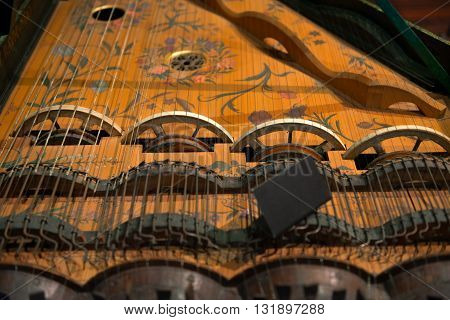 Closeup photo of an aged musical instrument
