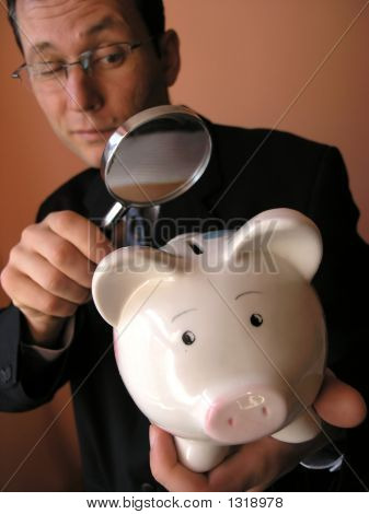 Businessman With A Piggy Bank