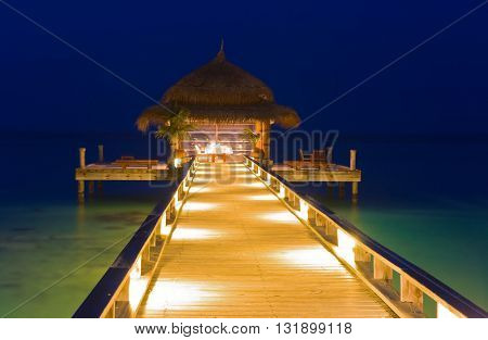 Water cafe at night - lights, ocean and sky