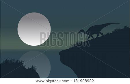 Iguanodon in riverbank with moon silhouette scenery a beautiful
