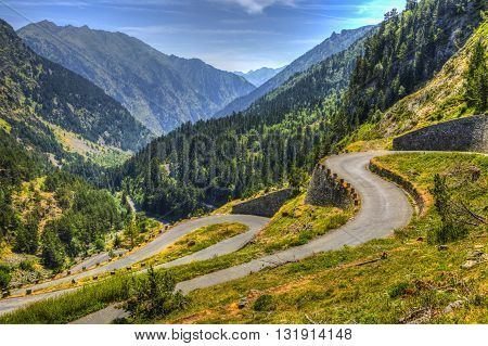Winding road in Pyrenees Mountains - Lakes Road (Route des Lacs) in Neouvielle Massif.