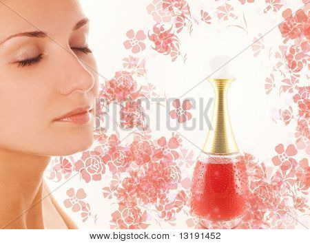 Beautiful girl's face and small perfume phial on abstract background