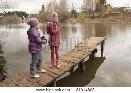 Girls Near The Lake In A Cloudy Day