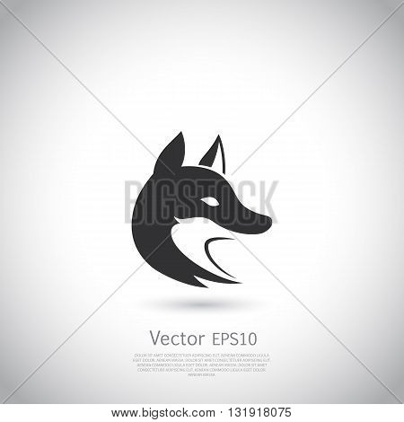 Stylized fox head. Vector silhouette with gray background.