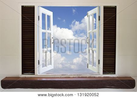 Open window in the skyOpen window against a wall the sky and cloud
