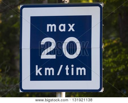 a roadsign regarding maximum speed 20 km per hour