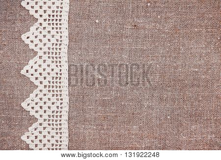 Vintage Background With Lace On The Old Burlap