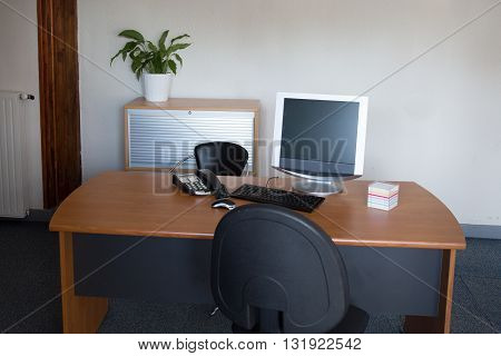 Manager Table With Desktop Computer Inside The Office.