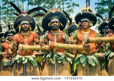 Playing Men In Papua New Guinea