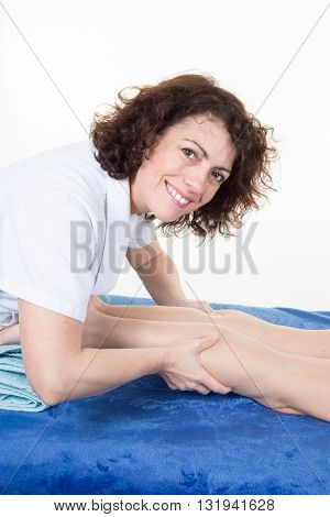 Woman Lying While Being Massaged By A Woman In A Room