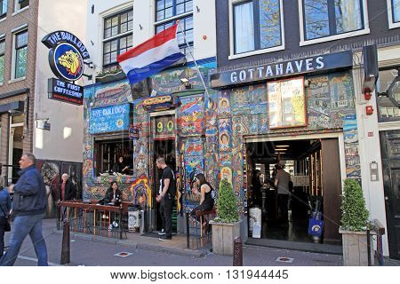 AMSTERDAM, NETHERLANDS - MAY 5, 2016: Cityscape with people and the coffeeshop Bulldog in Amsterdam, Netherlands. Bulldog was the first coffeshop and laid the benchmark for the contemporary coffeeshop.