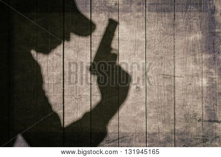 Black Armed Male Silhouette On The Wooden Fence.