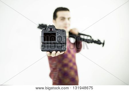DSLR camera in hand isolated. Black screen