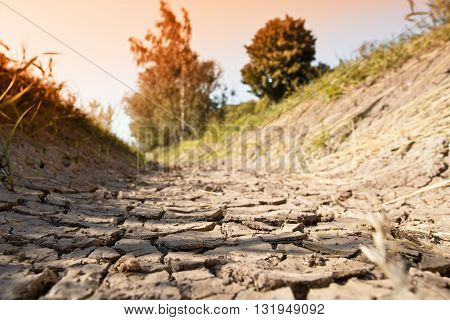 a dry creek bed in the hot summer