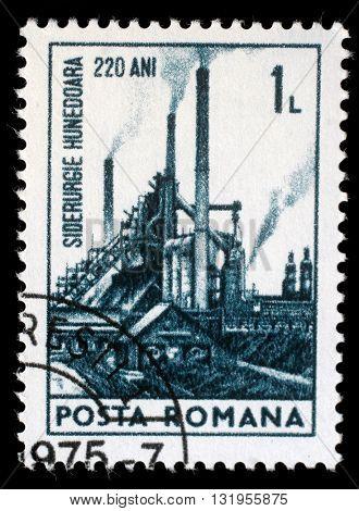 ZAGREB, CROATIA - JULY 18: a stamp printed in Romania shows 220th anniversary of Hunedoara Iron and Steel works, circa 1974, on July 18, 2012, Zagreb, Croatia