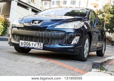 SOCHI RUSSIA - APRIL 29 2016: Peugeot 307 parked in the streets of Sochi. Peugeot is among the best-selling french automobiles in the world.