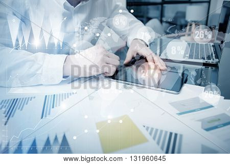Sales Department Work Online Process.Photo Trader working Market Report Documents Touching Screen Tablet.Using Graphics, Stock Exchanges Reports, Digital Interfaces.Business Project Startup.Horizontal