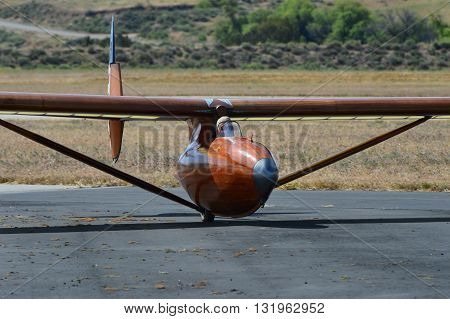 TEHACHAPI, CA - MAY 28, 2016: Jeff Byard rolls to a stop after landing his Bowlus Baby Albatross. a classic 1930s era glider, during the Western Vintage/Classic Regatta.