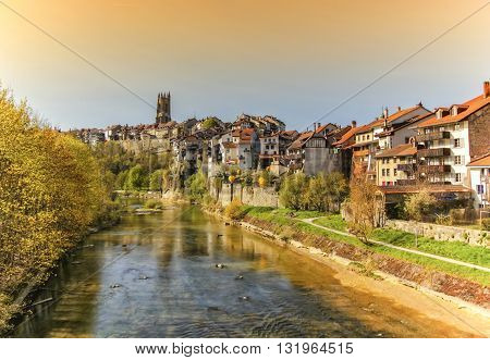 Panoramic view of cathedral of St. Nicholas and Sarine river in Fribourg, Switzerland
