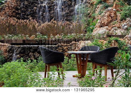 a table for 3 on the nature of a waterfall
