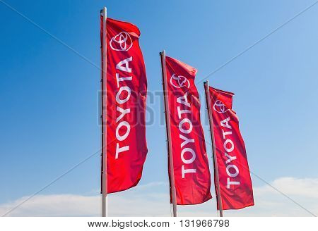 SAMARA RUSSIA - MAY 29 2016: Official dealership flags of Toyota against the blue sky background. Toyota Motor Corporation is a Japanese automotive manufacturer