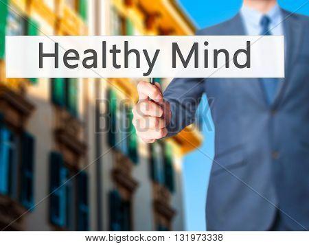 Healthy Mind - Businessman Hand Holding Sign