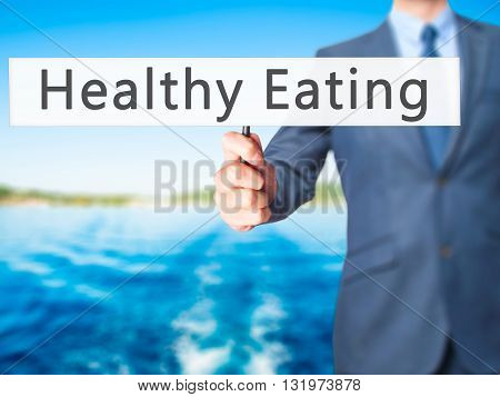 Healthy Eating - Businessman Hand Holding Sign