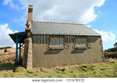 The  house with a gargoyle on the wall on the path of the customs officers, PERROS GUIREC  Brittany, France