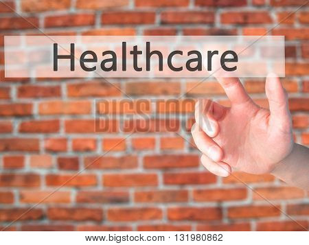 Healthcare - Hand Pressing A Button On Blurred Background Concept On Visual Screen.