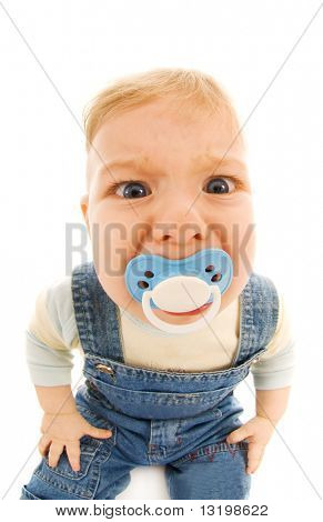 Funny baby sucking a dummy isolated on white background