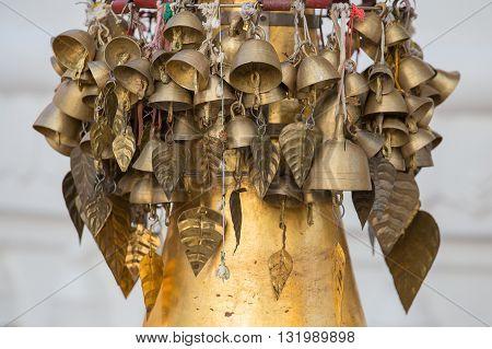 Bells on a golden stupa in Shwedagon Pagoda. Yangon Myanmar Burma