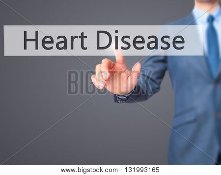 Heart Disease - Businessman Hand Pressing Button On Touch Screen Interface.