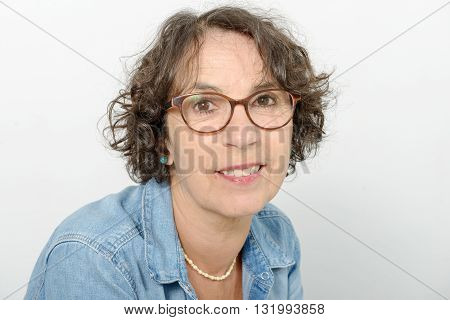a portrait of a middle-aged woman whit eyeglasses