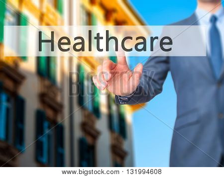 Healthcare - Businessman Hand Pressing Button On Touch Screen Interface.