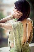 beautiful woman in light green saree indian attire poster