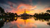 Beautiful sunset at the public park Suan Luang Rama IX. Ratchamangkhala pavillion and reflection in twilight time poster