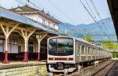 Local train at Nikko train station - Japan, Tochigi Prefecture poster